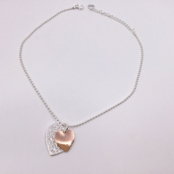 Silver beaded necklace with filigree heart & rose gold heart pendants