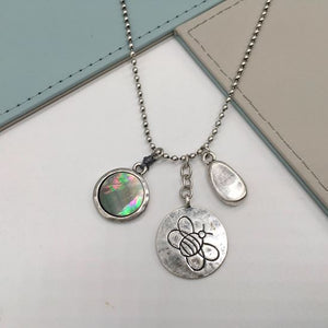 Silver bee and mother of pearl disc pendant necklace