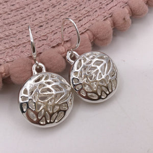 Silver round cut out earrings
