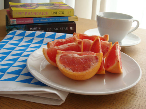 Geometric style blue triangles tea towel with blood orange breakfast [thedasherie.com]