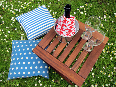 Red Deviled Eggs tea towel cooling wine at picnic in the garden with daisies [thedasherie.com]