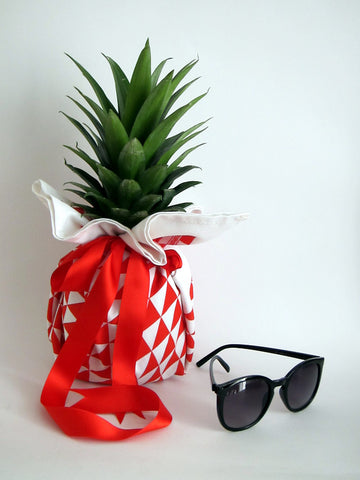Geometric style red triangles tea towel as gift wrap for Pineapple [TheDasherie.com]