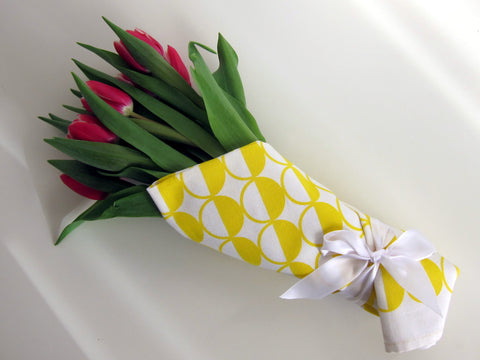 Retro, MCM style yellow half circles tea towel as gift wrap for flowers [thedasherie.com]