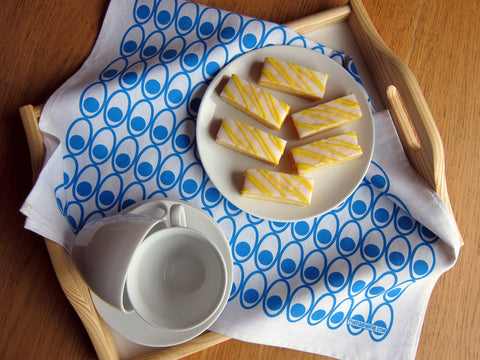 Scandinavian style blue deviled eggs tea towel as tray liner [thedasherie,com]