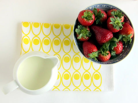 Scandinavian style yellow devilled eggs tea towel with strawberries and cream [thedasherie.com]