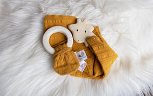 Giraffe Rubber Teether with a Mustard Muslin Comforter