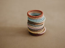 Load image into Gallery viewer, Mushie Silicone Pearl Teether Bracelets- Linen/Peony/Pale Pink