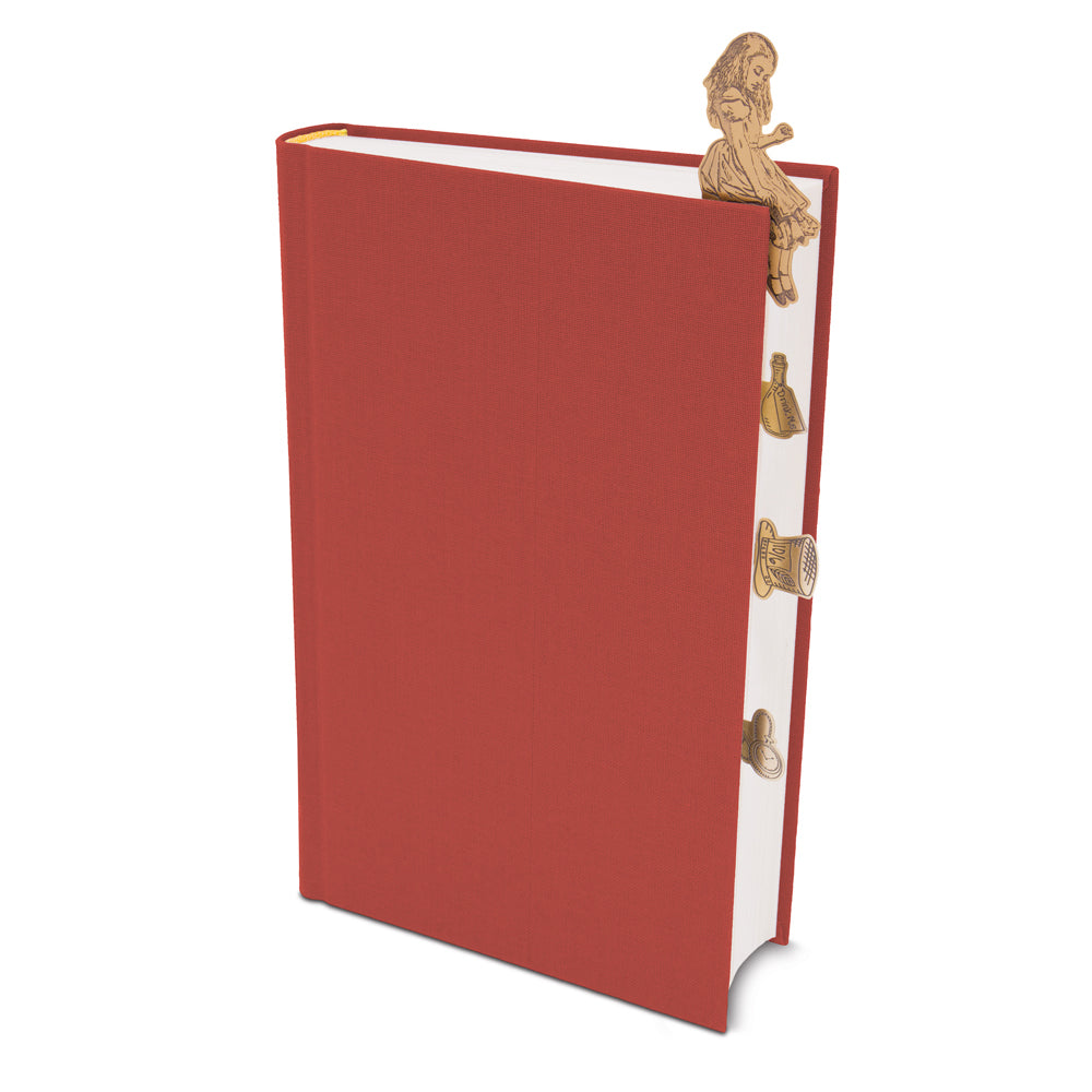 Image of Alice in Wonderland Brass Bookminders on a closed red book