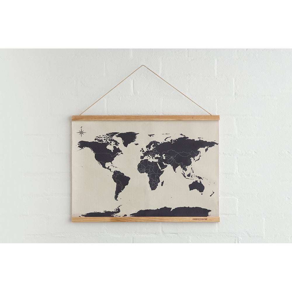 Cross Stitch Map blank on brick wall