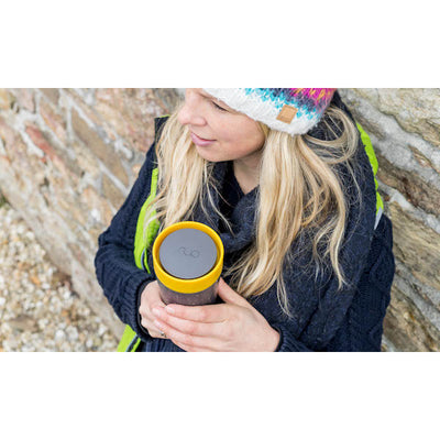 Reusable Coffee Cup 12oz Black/Mustard in use