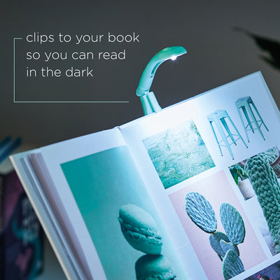 Image of Mint Green Book Light clipped onto book