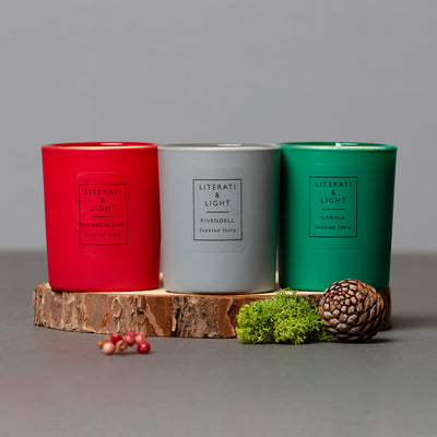 Magical Lands Candle Collection lifestyle shot on wood