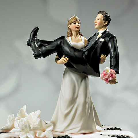 Bride holding Groom Wedding Cake Topper