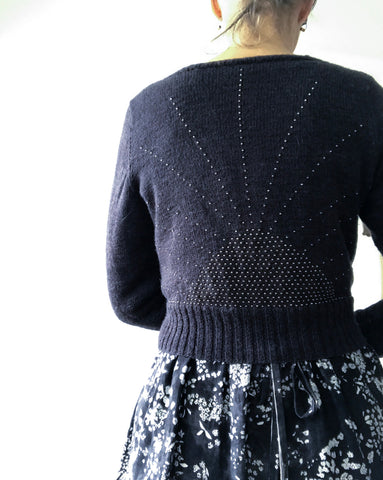 Back of black beaded cardigan with silver beads in sunray pattern