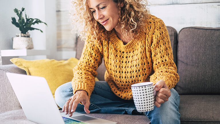 A woman in midlife researching what is perimenopause online