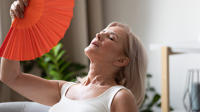 Woman experiencing the Most Common Symptoms of Menopause Hot Flashes