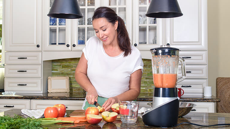 Woman in midlife obtaining more nutrients from food to help support their health