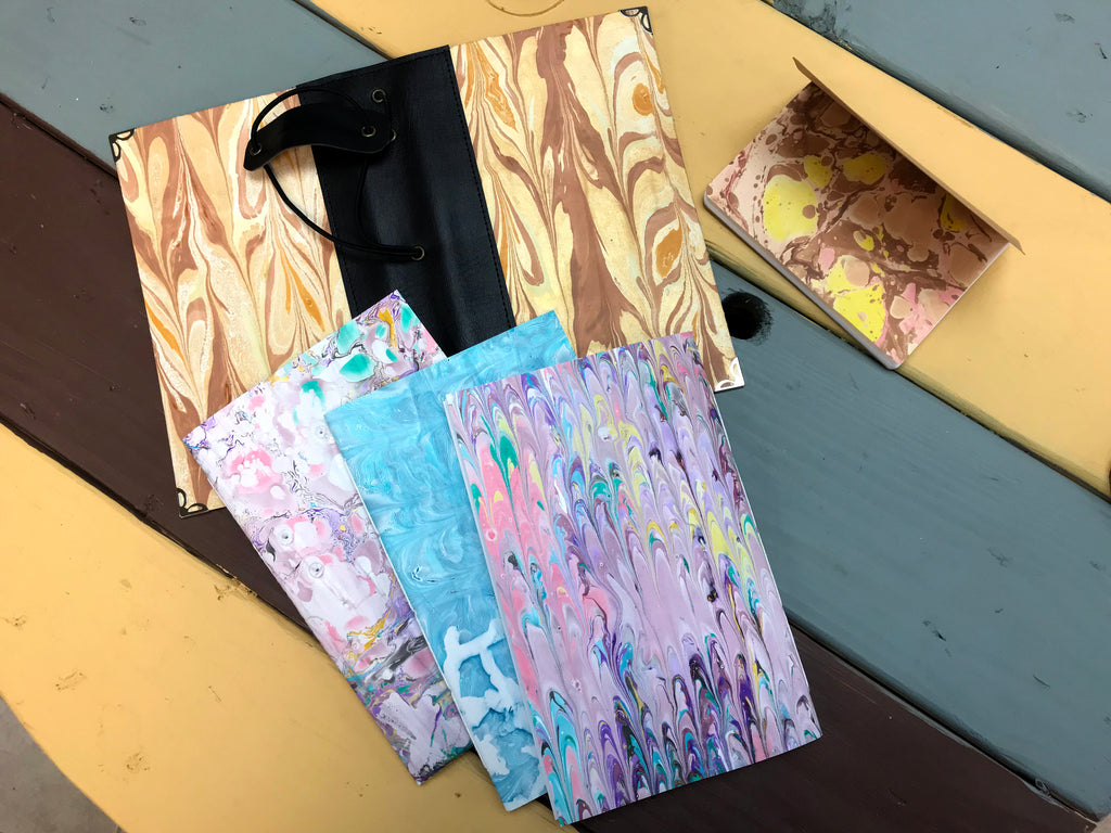 Marbled Traveler's notebook, with 3 refillable notebooks and 1 passport notebook. - OakPo Paper Co.