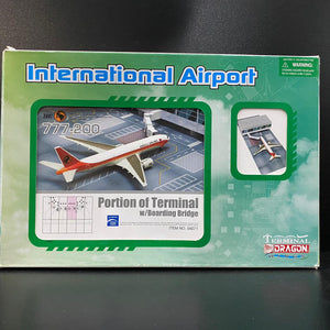 1/400 International Airport series: Portion of Terminal w/Boarding Bridge and TAAG Angola Airlines 777-200