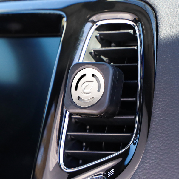 car interior with car vent clip in use