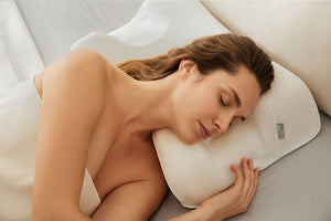 woman sleeping on anti-aging pillow