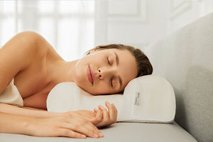 woman sleeping on an anti-aging pillow