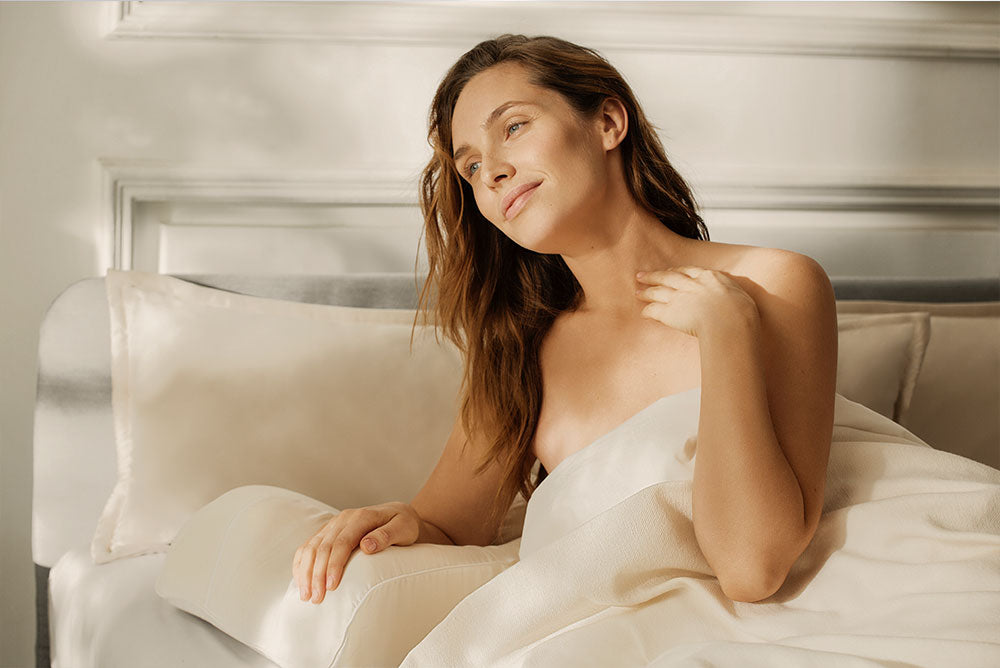 Woman waking up after sleeping on anti-aging pillow