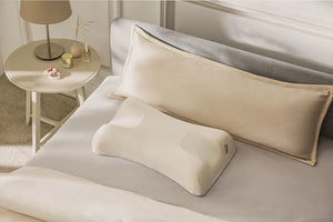 anti-aging pillow on a bed
