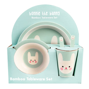 Pale blue/green kids dinner set with smiling bunny picture on, in cardboard packaging.