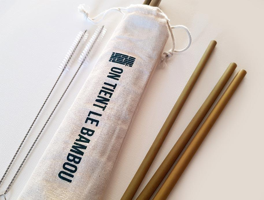 3 bamboo straws, shown with a cotton bag for storage, and 2 cleaning brushes