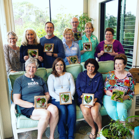 Showing off their botanical creations made during a private workshop!