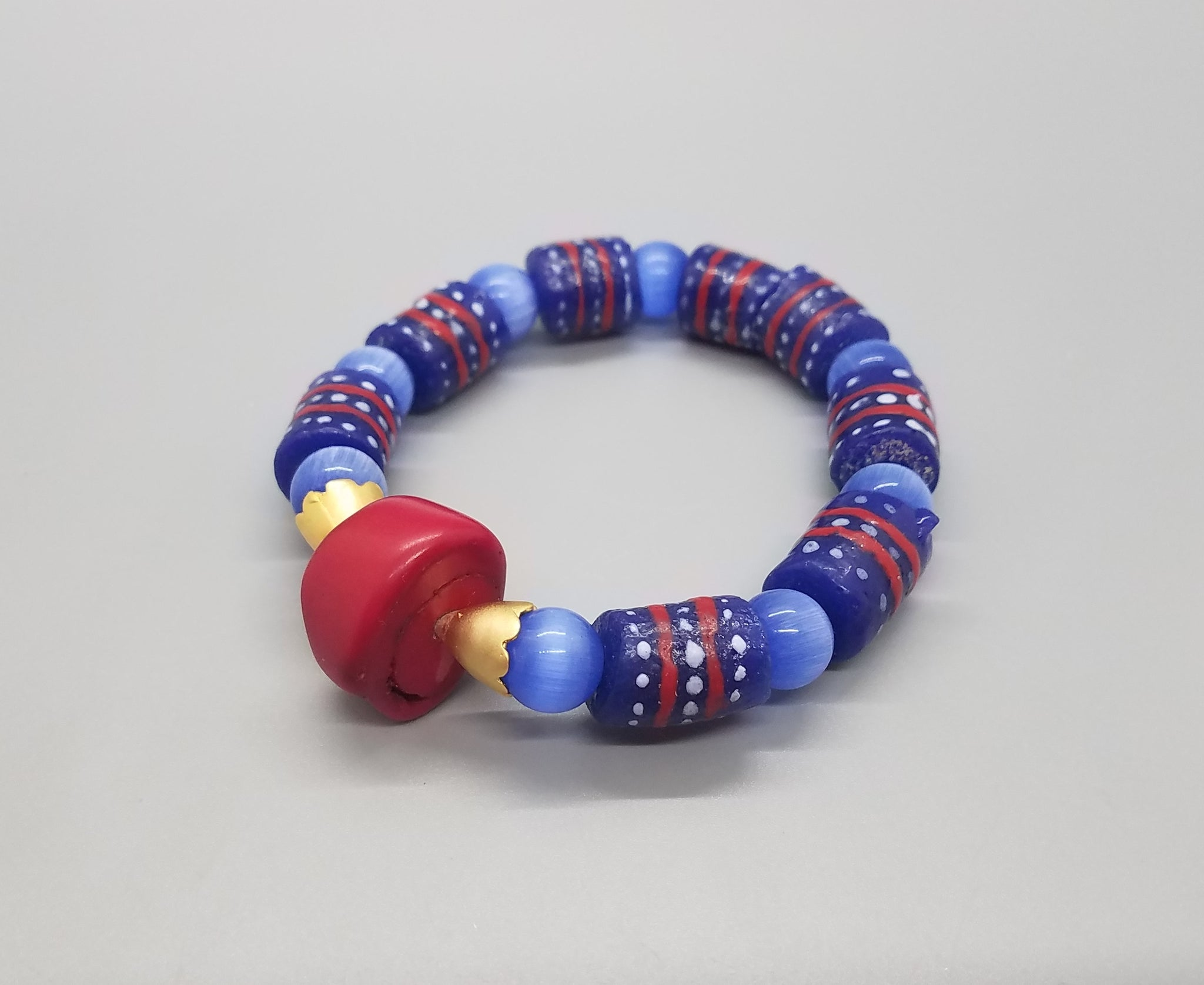 Red Blue Muti Krobo Beads, Blue Cat Eye Beads and Brass Stretch Bracelet