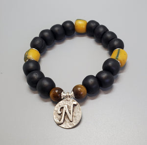 "Black, Must. Krobo Beads, Tiger Eye, Antique Silver Plated Brass ""N"" Charm, Brass, Unisex Stretch Bracelet"