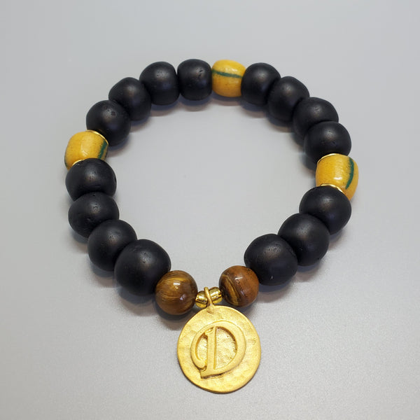 "Black, Must. Krobo Beads, Tiger Eye, 22K Gold Plated Plated Brass ""D"" Charm, Brass, Unisex Stretch Bracelet"