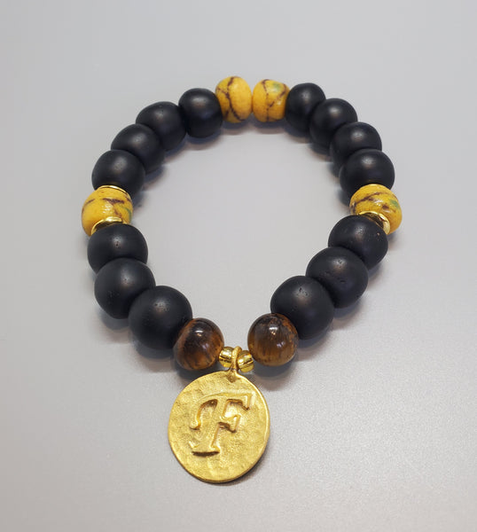 "Black, Must. Krobo Beads, Tiger Eye, 22K Gold Plated Plated Brass ""F"" Charm, Brass, Unisex Stretch Bracelet"
