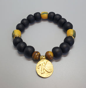 "Black, Must. Krobo Beads, Tiger Eye, 22K Gold Plated Plated Brass ""K"" Charm, Brass, Unisex Stretch Bracelet"