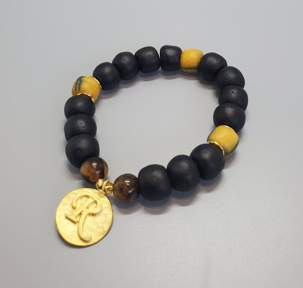 "Black, Must. Krobo Beads, Tiger Eye, 22K Gold Plated Plated Brass ""R"" Charm, Brass, Unisex Stretch Bracelet"