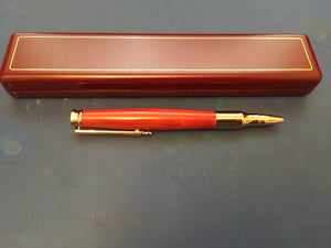 Hand Turned Hand Polished 30 Calibre Roller Ball Pen with 24ct Gold Fittings and a Red Heart Wood Barrel