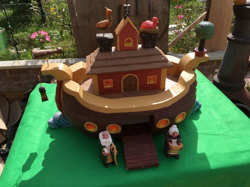 A Hand Carved and Hand Painted Model of Noah's Ark with Various Figures and Animals