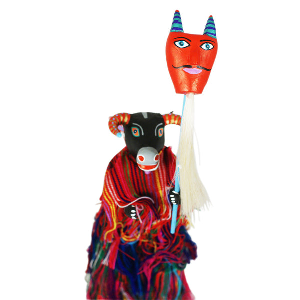 Martin Melchor: Cow on Stilts with Devil Mask