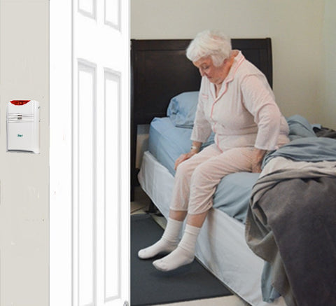 Floor mat with remote alarm for bed or doorway (alarm monitor is with carer)