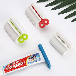 Load image into Gallery viewer, Rolling Tube Toothpaste Squeezer