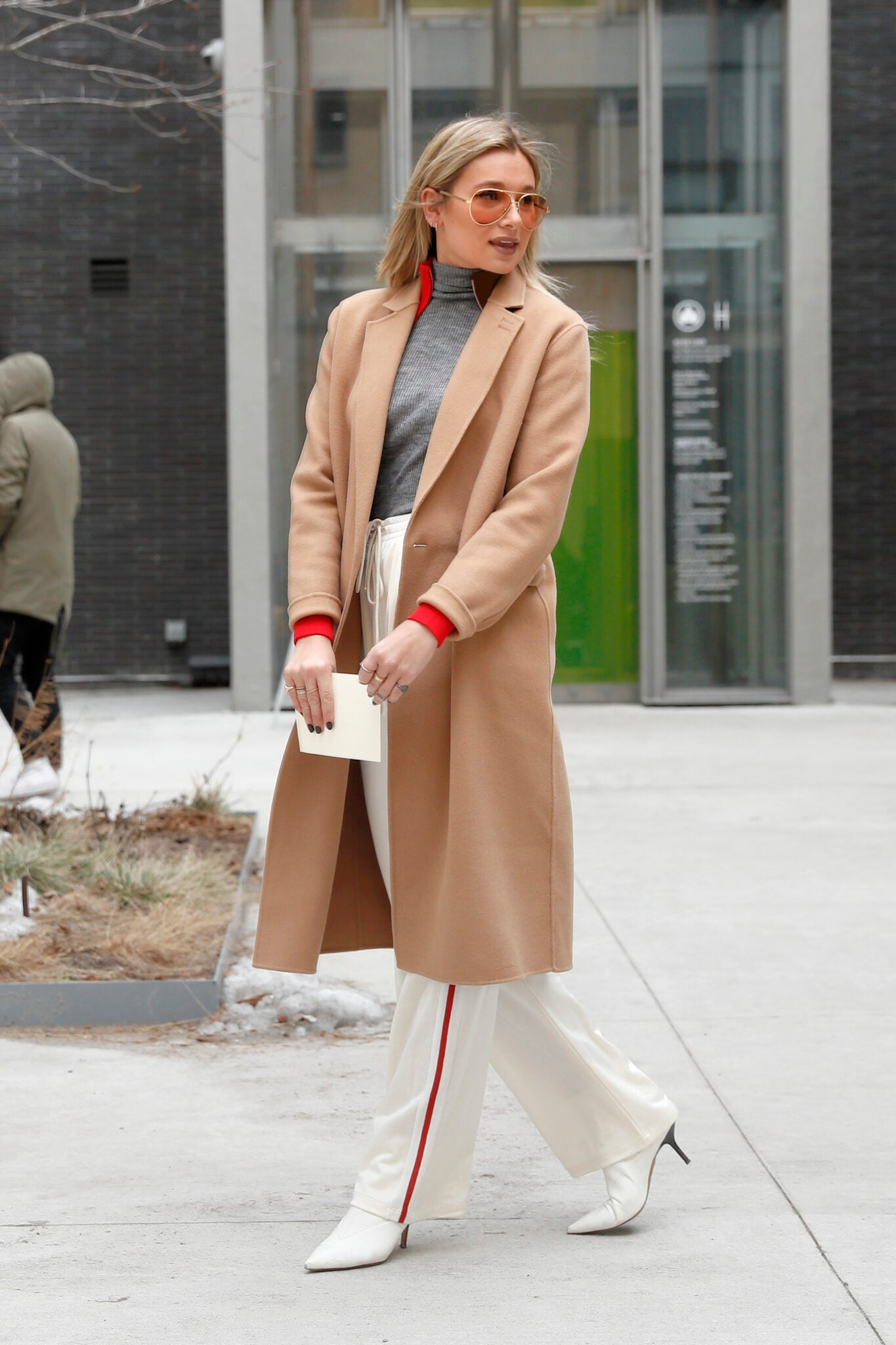 Who What Wear's Daniel Bernstein, wearing Maison Margiela white striped pants, Tory Burch camel coat and The Kooples' top, attends Tory Burch Fall-Winter 2017-18 show at Whitney Museum during New York Fashion Week in New York City on February 14, 2017. Pictured: Danielle Bernstein Ref: SPL1451070 140217 Picture by: Christopher Peterson/Splash News Splash News and Pictures Los Angeles: 310-821-2666 New York: 212-619-2666 London: 870-934-2666 photodesk@splashnews.com