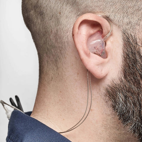 221 in-ear monitor being worn, side view