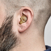 Full shell solid earplugs being worn, side view