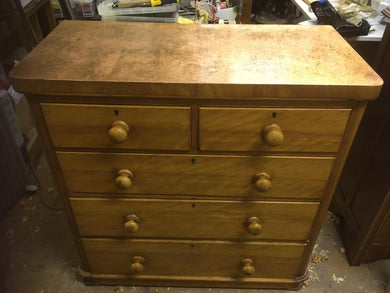 A Victorian satinwood chest drawers with Copper leaf and aged top