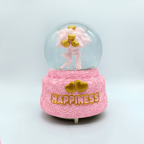 Pink Snow Globe with Couple kissing inside the glass ball