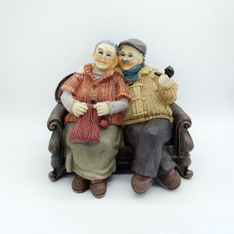 Old Couple Figurine Sitting together