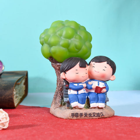 Hand Painted Couples Together Under Tree Figurine