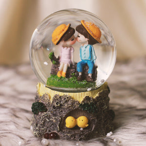 Cute Couples on Wooden Log: Musical Snow Dome
